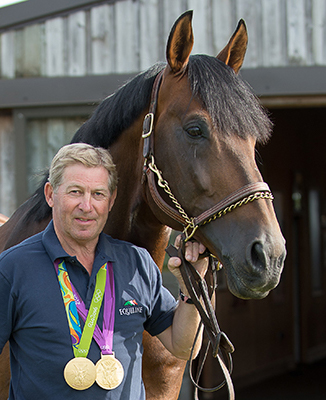 Nick Skelton with medals and horse
